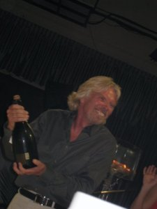 Richard Branson cracking open the champagne